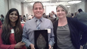 Publisher John Sotomayor accepts Diversity Award bestowed by REACH of City of Ocala. With Jamie Hirsch (left) and Margaret Renaud (right)